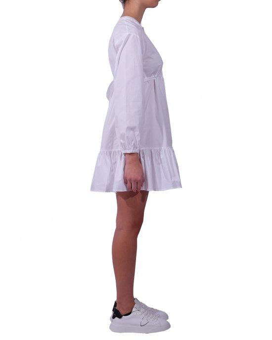 Abito Semicouture donna, tinta unita, modello tunica, manica lunga, con laccetto sul retro, taglio in vita, balza arricciata sul fondo. Bianco